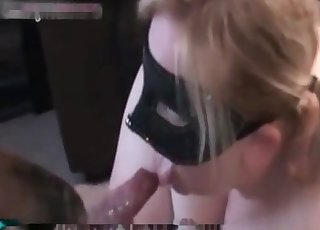 Masked chick sucks a huge doggy pipe